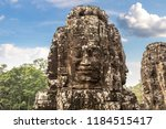 stone faces of bayon temple is... | Shutterstock . vector #1184515417