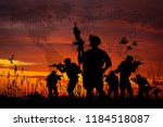 Silhouette of military soldiers with weapons dark background. Law and military concept.  - stock photo