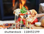 lifting slice of pizza with...   Shutterstock . vector #118452199