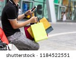 close up of young man holding... | Shutterstock . vector #1184522551