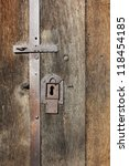 Old wooden doors and iron rusty lock - stock photo