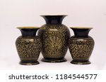 3 golden vases in a white... | Shutterstock . vector #1184544577