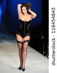 Small photo of Imodesty Blaize on the Agent Provocateur catwalk at the Lingerie London show at Old Bilinsgate Market, London 24/10/2012