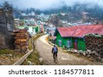 cyclist ride on unpaved village ... | Shutterstock . vector #1184577811