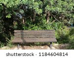 the bench is standing in the... | Shutterstock . vector #1184604814