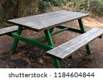 the bench is standing in the... | Shutterstock . vector #1184604844