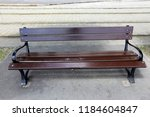 the bench is standing in the... | Shutterstock . vector #1184604847