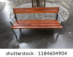 the bench is standing in the... | Shutterstock . vector #1184604904