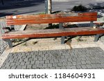 the bench is standing in the... | Shutterstock . vector #1184604931