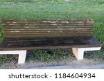 the bench is standing in the... | Shutterstock . vector #1184604934