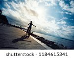hands free cycling woman riding ... | Shutterstock . vector #1184615341