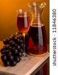 a glass and a bottle grape - stock photo