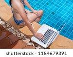 asian bikini woman sexy in pool ...   Shutterstock . vector #1184679391