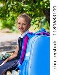 an elementary school student... | Shutterstock . vector #1184683144