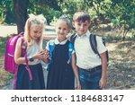 three elementary school... | Shutterstock . vector #1184683147