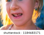portrait of a little girl with... | Shutterstock . vector #1184683171