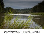 view on river and forests in... | Shutterstock . vector #1184703481