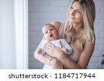 newborn baby in a tender... | Shutterstock . vector #1184717944