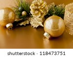 Golden Christmas background with balls and pine cone. selective focus, shallow dof - stock photo