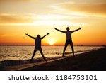 young happy couple on seashore... | Shutterstock . vector #1184753101