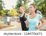 group of sporty people running... | Shutterstock . vector #1184756671