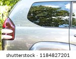 side view of a car parked on... | Shutterstock . vector #1184827201