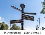 town signpost showing... | Shutterstock . vector #1184849587
