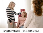 Cute Caucasian girl and her mother talking with pediatrician at hospital. - stock photo