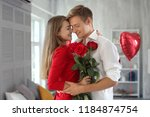 happy young couple with red... | Shutterstock . vector #1184874754