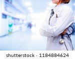 doctor standing and crossed arm ... | Shutterstock . vector #1184884624