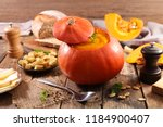 pumpkin soup with bread on wood ... | Shutterstock . vector #1184900407