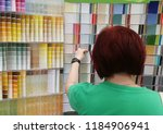 the girl looks at the color... | Shutterstock . vector #1184906941