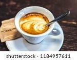 coffee macchiato with almond...   Shutterstock . vector #1184957611