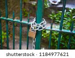 green gate with a lock | Shutterstock . vector #1184977621