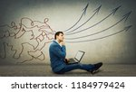 pensive businessman sitting...   Shutterstock . vector #1184979424