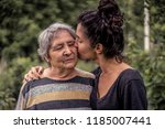 young woman and her grandmother ... | Shutterstock . vector #1185007441