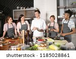 chef and group of young people... | Shutterstock . vector #1185028861