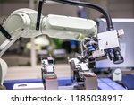 the robot arm on the production ... | Shutterstock . vector #1185038917