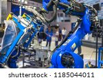 robotic arm at industrial... | Shutterstock . vector #1185044011