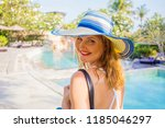woman walking by swimming pools ... | Shutterstock . vector #1185046297