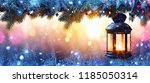 christmas lantern on snow with ... | Shutterstock . vector #1185050314