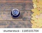 a cup of tea among a set of... | Shutterstock . vector #1185101704