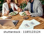 business lunch. man and woman... | Shutterstock . vector #1185123124