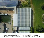 aerial drone flight over... | Shutterstock . vector #1185124957