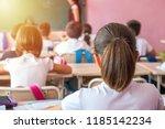 group of school kids sitting... | Shutterstock . vector #1185142234