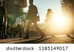 men and woman commuting to... | Shutterstock . vector #1185149017