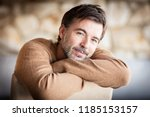 portrait of a handsome mature... | Shutterstock . vector #1185153157