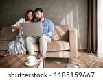 happy couple searching... | Shutterstock . vector #1185159667