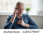 stressed senior mature man... | Shutterstock . vector #1185179047
