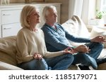 calm senior middle aged couple... | Shutterstock . vector #1185179071